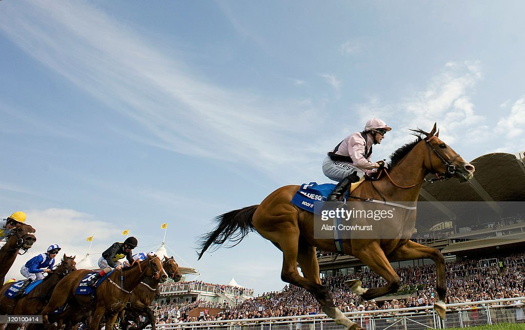 Kieren Fallon riding Hoof It win the Blue Square Stewards' Cup at Goodwood racecourse on July 30 2011 in Chichester England