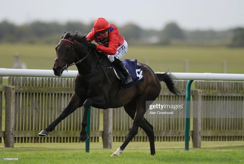 Kieren Fallon riding Mohedian Lady win The Princess Royal Richard Hambro EBF Stakes at Newmarket racecourse on September 22 2011 in Newmarket England