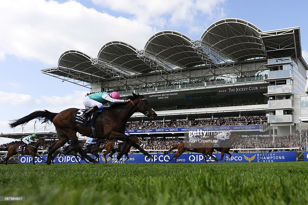 Kieren Fallon riding Night Of Thunder win The Qipco 2000 Guineas Stakes from Kingman at Newmarket racecourse on May 03 2014 in Newmarket England
