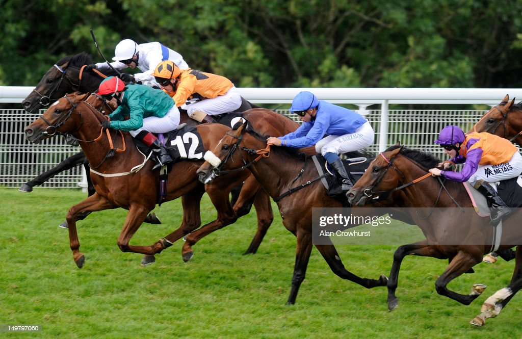 Kieren Fallon riding Steeler (L, green) win The Natwest Ahead For Business EBF Maiden Stakes at Goodwood racecourse on August 04, 2012 in Chichester, England.