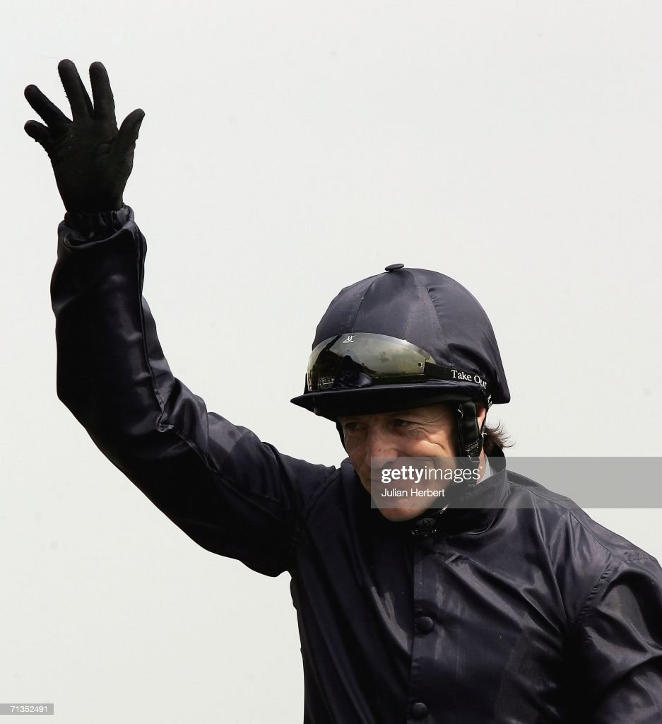 Kieren Fallon salutes his and Dylan Thomas victory in The Budweiser Irish Derby run at The Curragh Racecourse on July 2 2006 at The Curragh Ireland