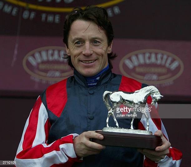 Kieren Fallon with the trophy he was presented with after becoming champion flat jockey for the 20003 season on November 8 2003 at Doncaster England...