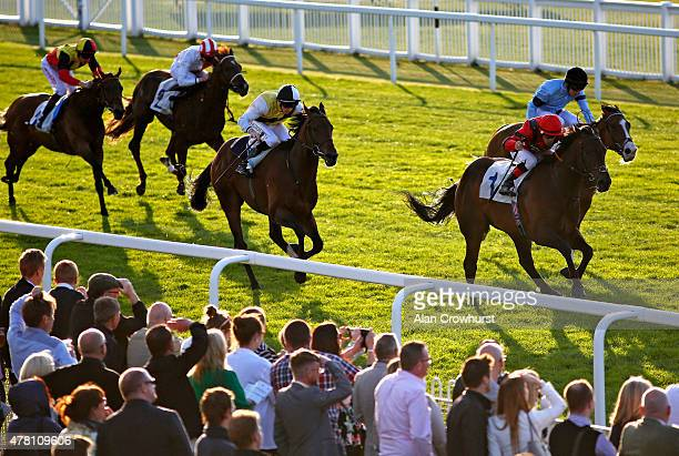 Kieren Fox riding Mullionheir wins The Asset Finance Solutions Funding UK Business Handicap Stakes at Windsor racecourse on June 22 2015 in Windsor...