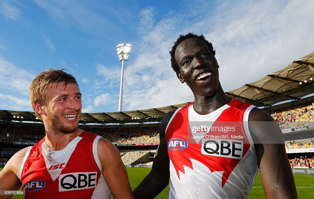 Kieren Jack and Aliir Aliir celebrate during the round six AFL match between the Brisbane Lions and the Sydney Swans at The Gabba on May 1, 2016 in Brisbane, Australia.