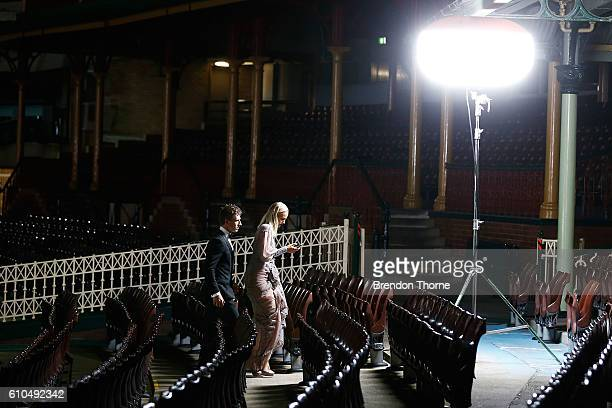 Kieren Jack and Charlotte Goodlet walk through the members stand prior to a Sydney Swans function at Sydney Cricket Ground ahead of the 2016 AFL...