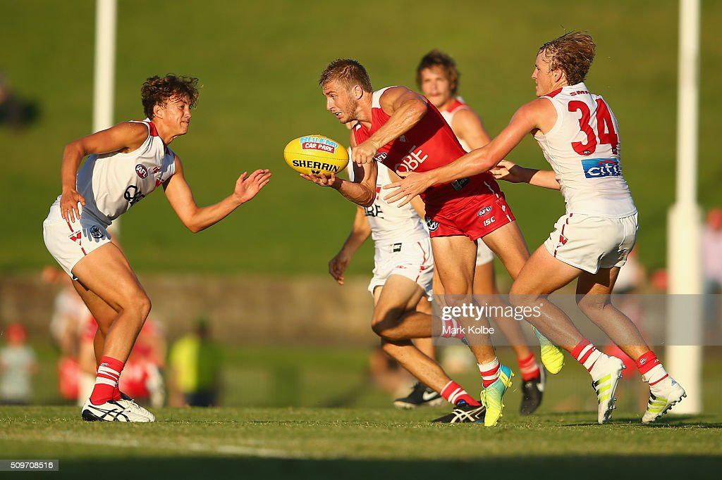 Kieren Jack of the Red Team hand ball under pressure from Jordan Dawson of the White Team during the Sydney Swans AFL intra-club match at Henson Park on February 12, 2016 in Sydney, Australia.