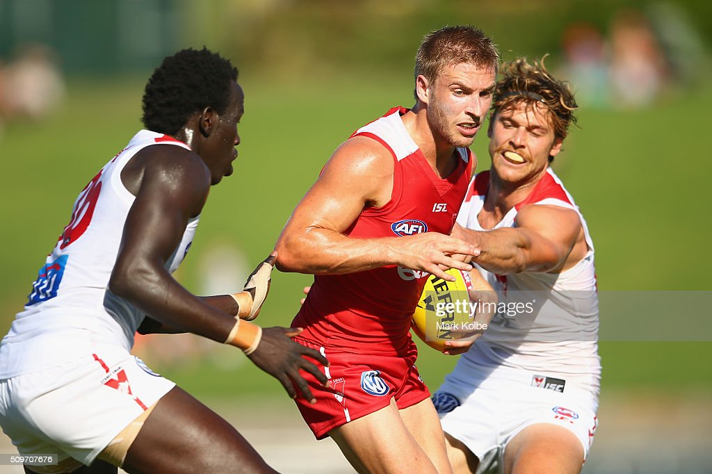 Kieren Jack of the Red Team is tackled by Aliir Aliir and Dane Rampe of the White Team during the Sydney Swans AFL intra-club match at Henson Park on February 12, 2016 in Sydney, Australia.
