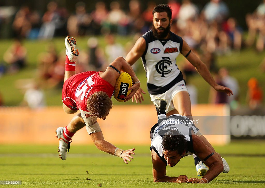 Kieren Jack of the Swans falls next to Mitch Robinson of the Blues during the round one AFL NAB Cup match between the Sydney Swans and the Carlton Blues at Blacktown International Sportspark on February 24, 2013 in Sydney, Australia.