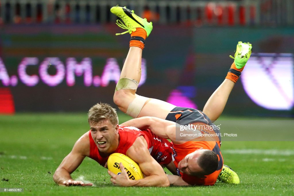 Kieren Jack of the Swans is tackled during the round 17 AFL match between the Greater Western Sydney Giants and the Sydney Swans at Spotless Stadium on July 15, 2017 in Sydney, Australia.