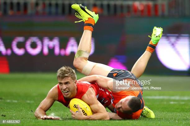 Kieren Jack of the Swans is tackled during the round 17 AFL match between the Greater Western Sydney Giants and the Sydney Swans at Spotless Stadium...