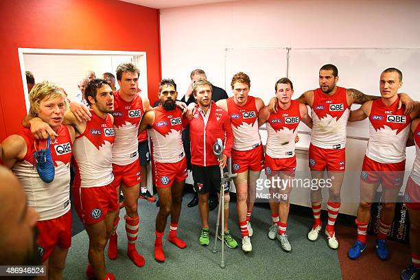 Kieren Jack of the Swans sings the club song with team mates after the round 23 AFL match between the Sydney Swans and the Gold Coast Suns at Sydney...