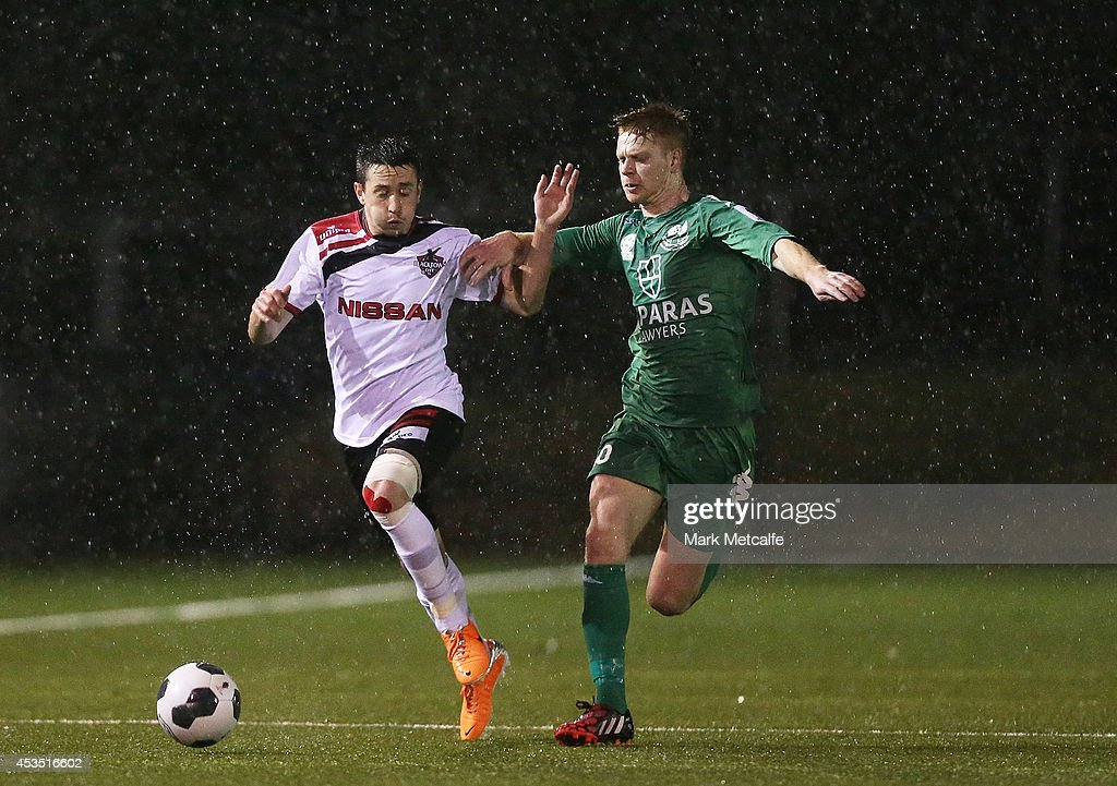 Kieren Paull of Blacktown City is challenged by David Stirton of Bentleigh Greens during the FFA Cup match between Blacktown City and Bentleigh Greens at Lilys Football Centre on August 12, 2014 in Blacktown, Australia.