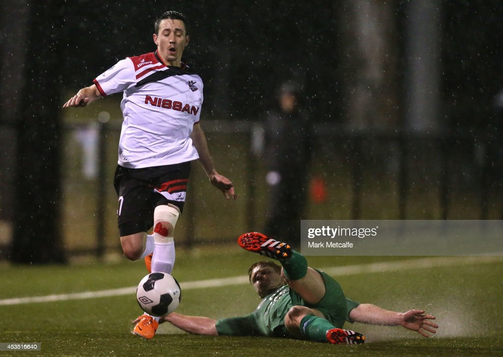 Kieren Paull of Blacktown City is tackled by David Stirton of Bentleigh Greens during the FFA Cup match between Blacktown City and Bentleigh Greens at Lilys Football Centre on August 12, 2014 in Blacktown, Australia.