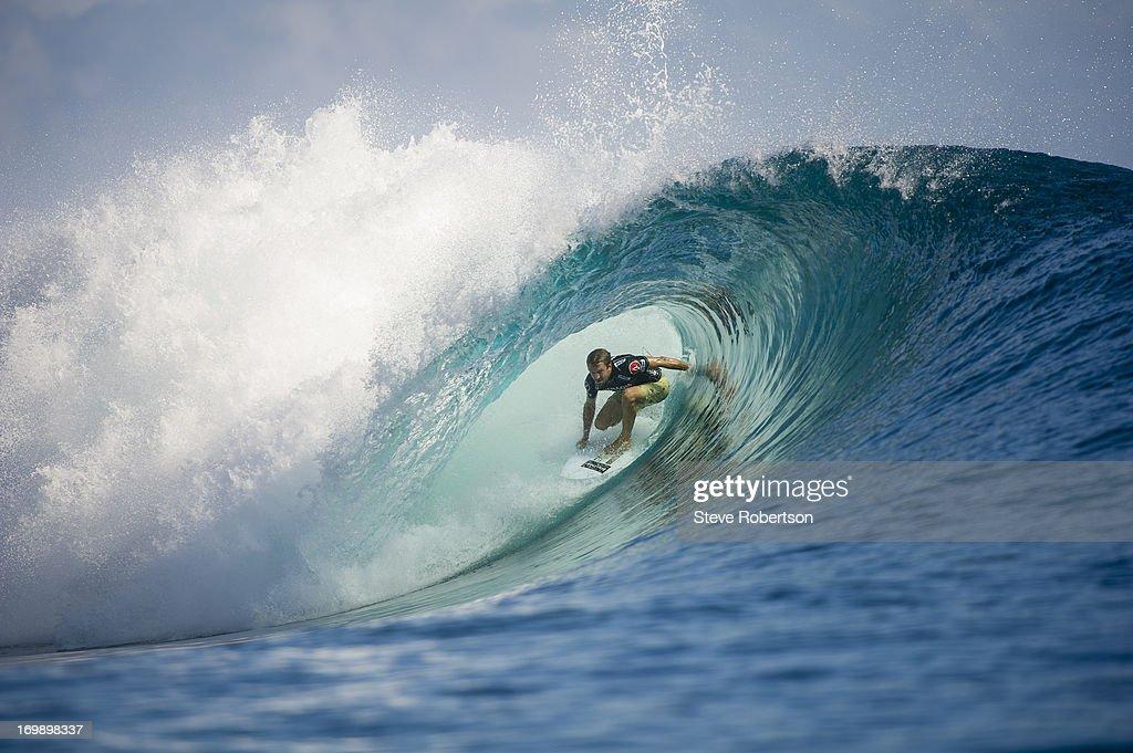 Kieren Perrow of Australia rides deep in the barrel as he wins round one at the Volcom Pro Fiji on June 4, 2013 in Tavarua, Fiji.