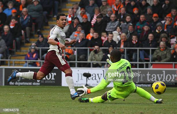 Kieren Richardson of Sunderland beats Richard Kingson of Blackpool to score the opening goal during the Barclays Premier League match between...