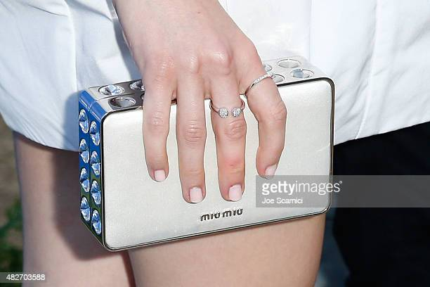 Kiernan Shipka clutch detail attends the 8th Annual Oceana SeaChange Summer Party at Strands Beach on August 1 2015 in Dana Point California