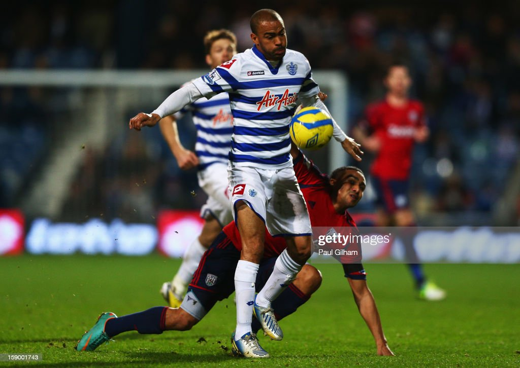 <a gi-track='captionPersonalityLinkClicked' href=/galleries/search?phrase=Kieron+Dyer&family=editorial&specificpeople=206216 ng-click='$event.stopPropagation()'>Kieron Dyer</a> of Queens Park Rangers battles for the ball with Jerome Thomas of West Bromwich Albion during the FA Cup with Budweiser Third Round match between Queens Park Rangers and West Bromwich Albion at Loftus Road on January 5, 2013 in London, England.