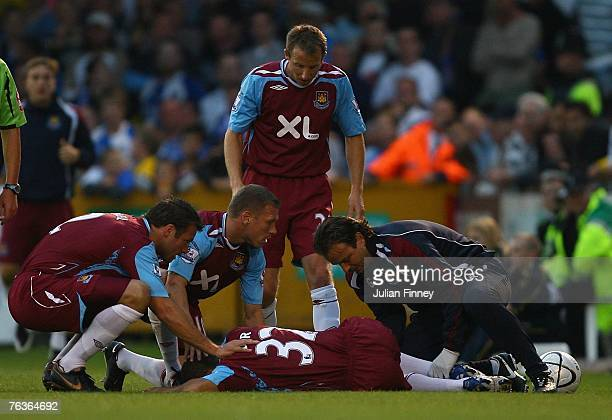 Kieron Dyer of West Ham receives treatment after an injury during the Carling Cup match between Bristol Rovers and West Ham United at the Memorial...