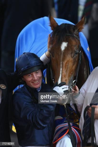 Kieron Fallon of Ireland celebrates with Dylan Thomas after winning the Prix de L'Arc de Triomphe at the Hippodrome de Longchamp on October 7 2007 in...