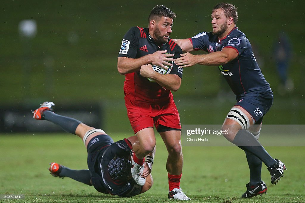 Kieron Fonotia of the Crusaders is tackled during the Super Rugby pre-season match between the Reds and the Crusaders at Ballymore Stadium on February 6, 2016 in Brisbane, Australia.