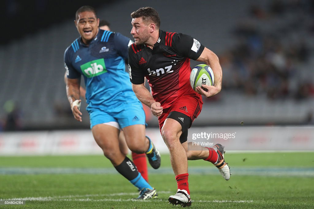 Kieron Fonotia of the Crusaders makes a break during the round 14 Super Rugby match between the Blues and the Crusaders at Eden Park on May 28, 2016 in Auckland, New Zealand.