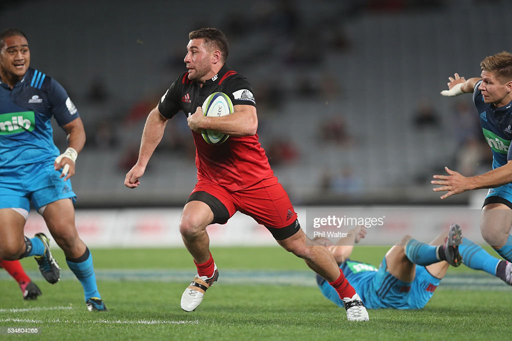 Kieron Fonotia of the Crusaders tramples over Ihaia West of the Blues during the round 14 Super Rugby match between the Blues and the Crusaders at Eden Park on May 28, 2016 in Auckland, New Zealand.