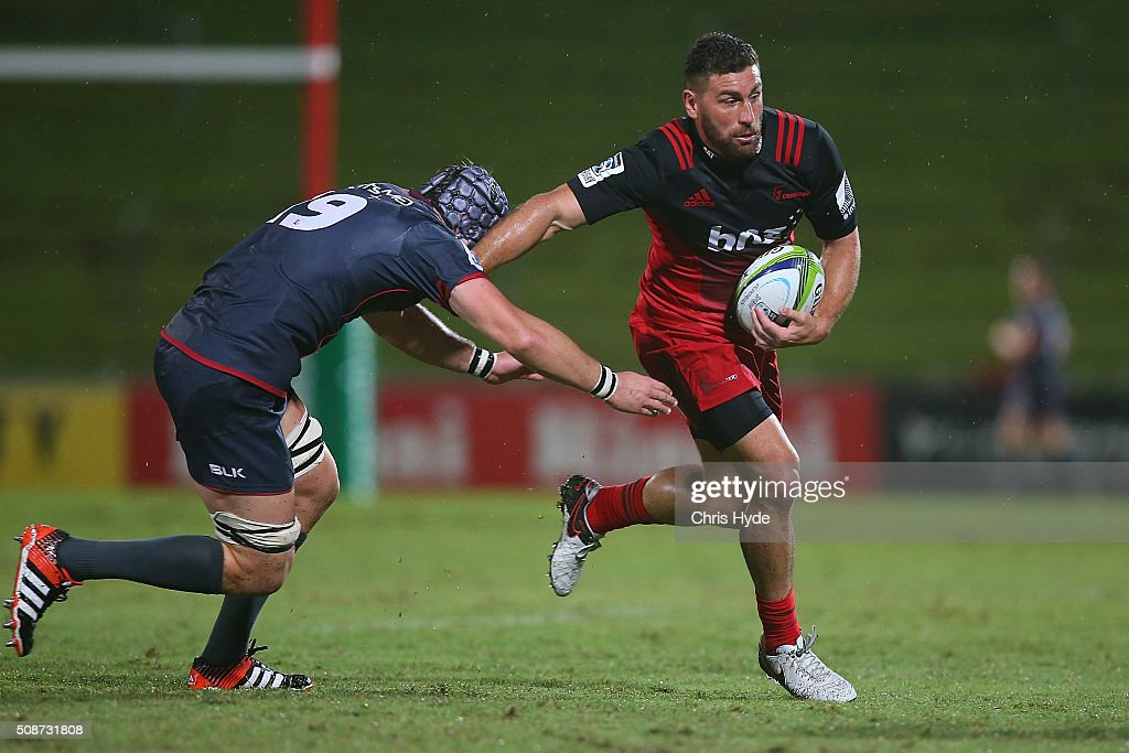 Kieron Fonotia of the Crusadersmakes a break during the Super Rugby pre-season match between the Reds and the Crusaders at Ballymore Stadium on February 6, 2016 in Brisbane, Australia.