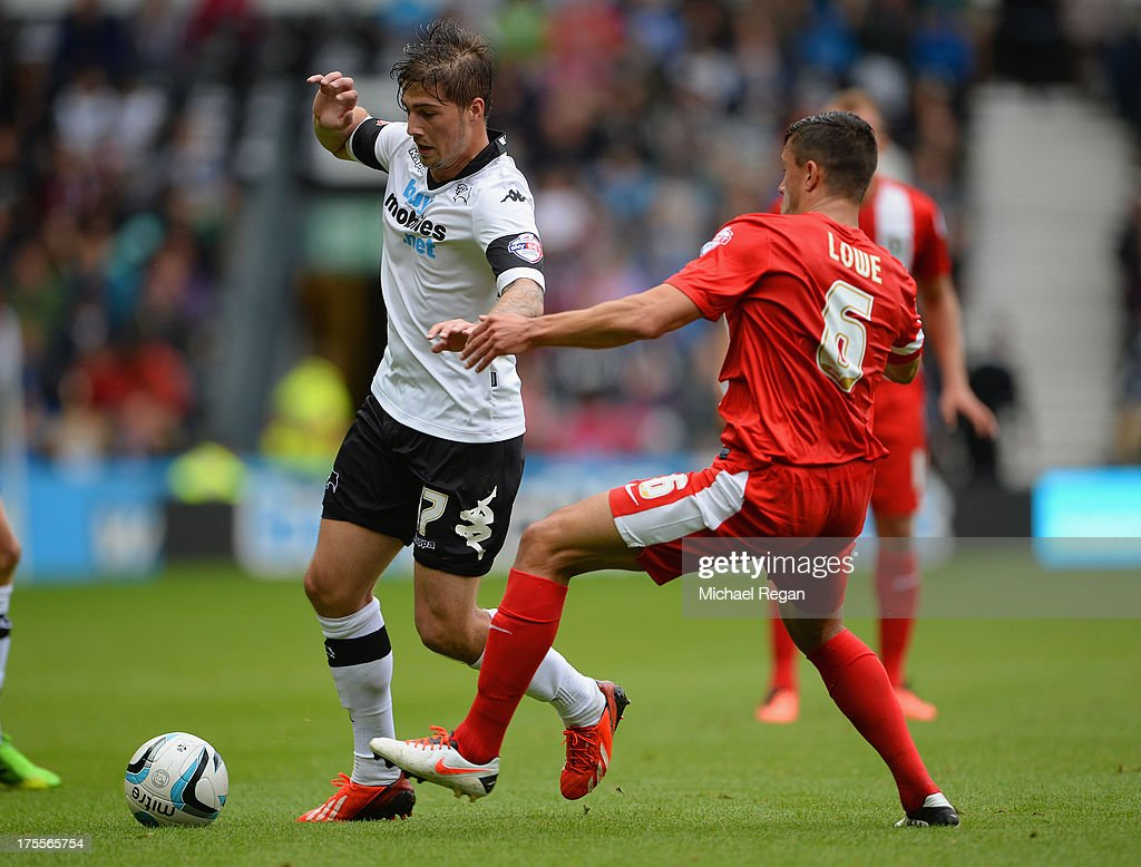 Kieron Freeman of Derby takes on Jason Lowe of Blackburn during the Sky Bet Championship match between Derby County and Blackburn Rovers at Pride Park Stadium on August 04, 2013 in Derby, England,