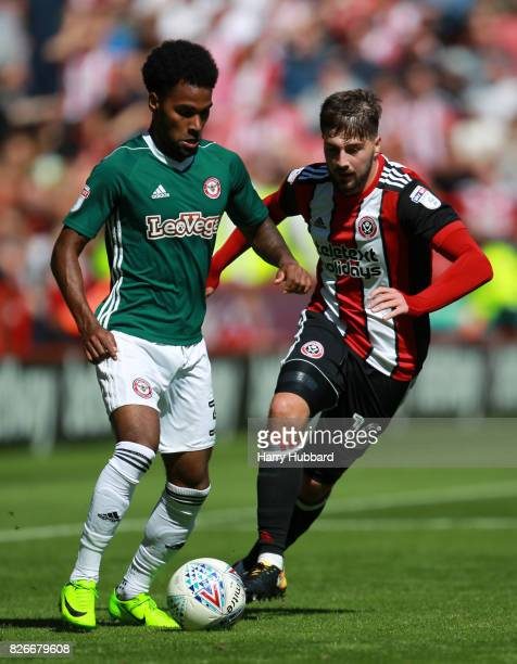 Kieron Freeman of Sheffield United and Rico Henry of Brentford in action during the Sky Bet Championship match between Sheffield United and Brentford...