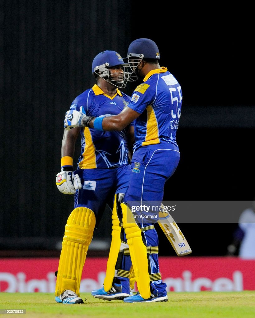 Kieron Pollard (R) congratulates Dwayne Smith (L) of Barbados Tridents for his century during a match between Barbados Tridents and St. Lucia Zouks as part of the week 3 of Caribbean Premier League 2014 at Kensington Oval on July 23, 2014 in Bridgetown, Barbados.