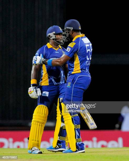 Kieron Pollard congratulates Dwayne Smith of Barbados Tridents for his century during a match between Barbados Tridents and St Lucia Zouks as part of...
