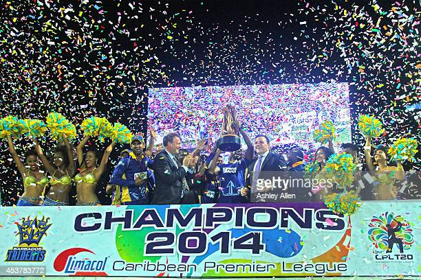 Kieron Pollard lifts the trophy after the Limacol Caribbean Premier League 2014 final match between Guyana Amazon Warriors and Barbados Tridents at...