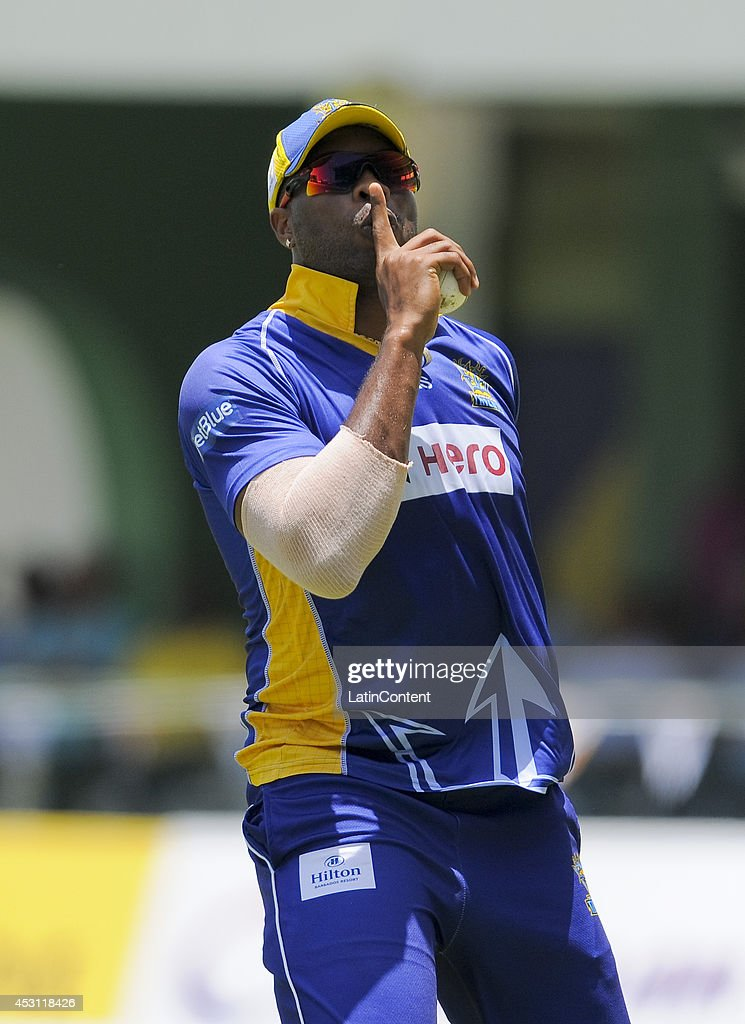 Kieron Pollard of Barbados Tridents celebrates taking the catch to dismiss Andre Russell of Jamaica Tallawahs during a match between Jamaica Tallawahs and Barbados Tridents as part of week 4 of the Caribbean Premier League 2014 at Sabina Park on August 03, 2014 in Kingston, Jamaica.