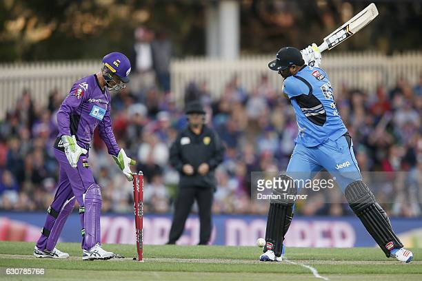 Kieron Pollard of the Adelaide Strikers is bowled by Clive Rose of the Hobart Hurricanes during the Big Bash League match between the Hobart...