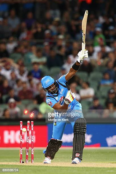 Kieron Pollard of the Adelaide Strikers is bowled out by Ben Cutting of the Brisbane Heat during the Big Bash League match between the Adelaide...