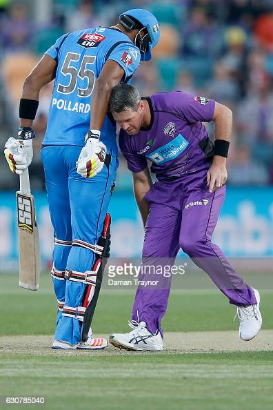 Kieron Pollard of the Adelaide Strikers stands his ground as Dan Christian of the Hobart Hurricanes fields the ball during the Big Bash League match...