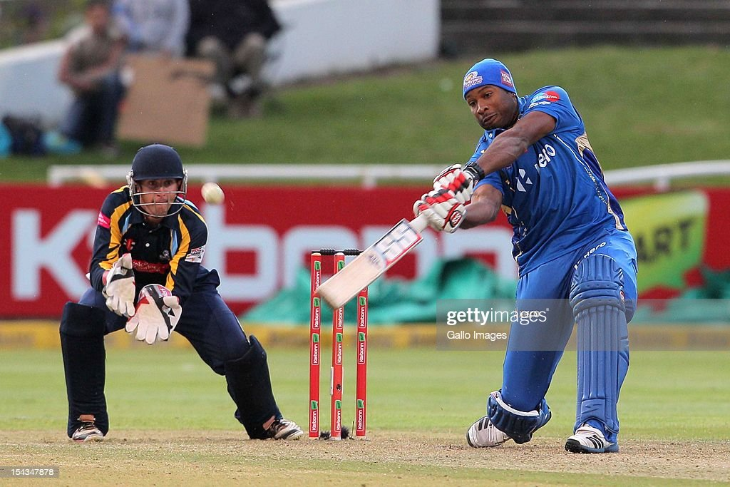 Kieron Pollard of the Mumbai Indians bats as wicketkeeper Dan Hodgson (L) of Yorkshire looks on during the Karbonn Smart CLT20 match between Mumbai Indians (IPL) and Yorkshire (England) at Sahara Park Newlands on October 18, 2012 in Cape Town, South Africa.