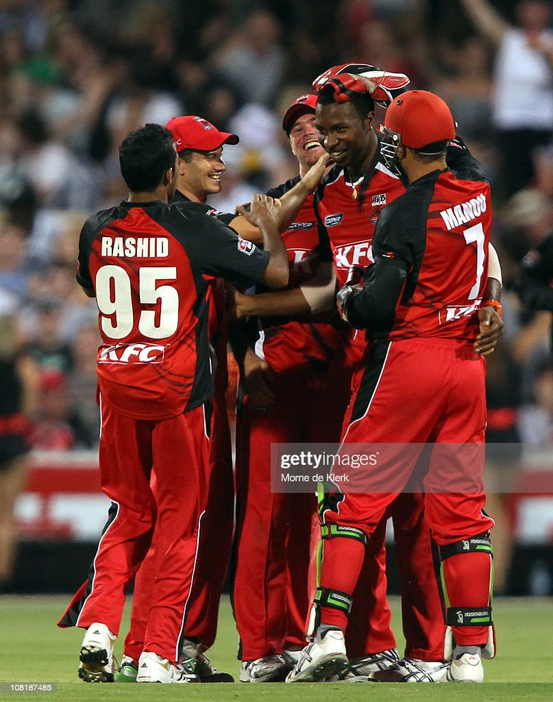 Kieron Pollard of the Redbacks celebrates with team mates after he caused the run out of Nathan Reardon of the Bulls during the Twenty20 Big Bash match between the South Australian Redbacks and the Queensland Bulls at Adelaide Oval on January 20, 2011 in Adelaide, Australia.