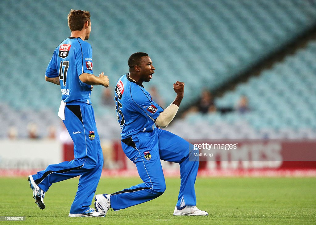 Kieron Pollard (R) of the Strikers celebrates taking the wicket of Chris Gayle of the Thunder during the Big Bash League match between the Sydney Thunder and the Adelaide Strikers at ANZ Stadium on December 20, 2012 in Sydney, Australia.