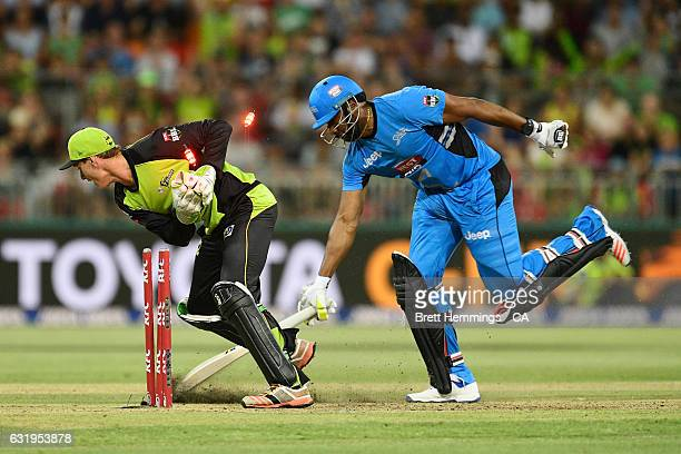 Kieron Pollard of the Strikers is run out by Jay Lenton of the Thunder during the Big Bash League match between the Sydney Thunder and the Adelaide...