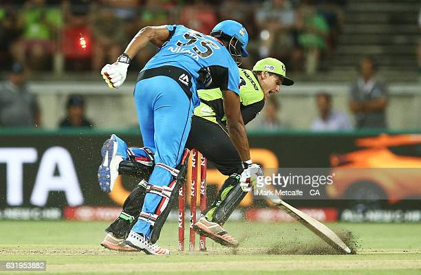Kieron Pollard of the Strikers is runout by Jay Lenton of the Thunder during the Big Bash League match between the Sydney Thunder and the Adelaide...