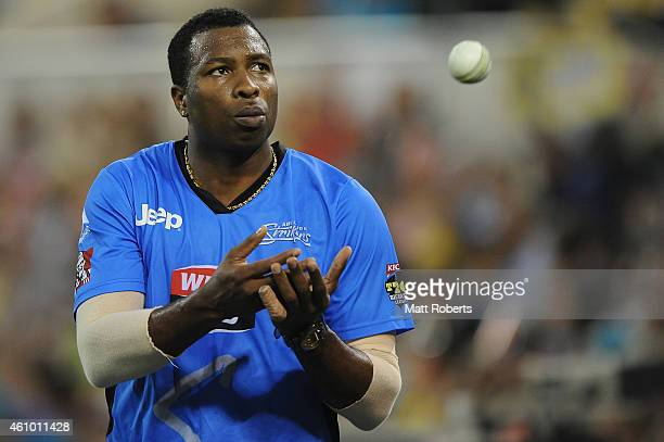 Kieron Pollard of the Strikers receives the ball during the Big Bash league match between the Brisbane Heat and the Adelaide Strikers at The Gabba on...