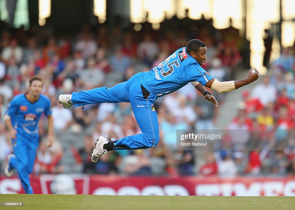 Kieron Pollard of the Strikers takes a catch off his own bowling to dismiss Ben Rohrer of the Renegades during the Big Bash League match between the Melbourne Renegades and the Adelaide Strikers at Etihad Stadium on January 2, 2013 in Melbourne, Australia.