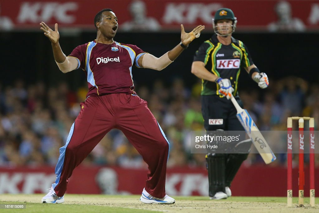 <a gi-track='captionPersonalityLinkClicked' href=/galleries/search?phrase=Kieron+Pollard&family=editorial&specificpeople=4233862 ng-click='$event.stopPropagation()'>Kieron Pollard</a> of the West Indies celebrates after dismissing Brad Haddin of Australia during the International Twenty20 match between Australia and the West Indies at The Gabba on February 13, 2013 in Brisbane, Australia.