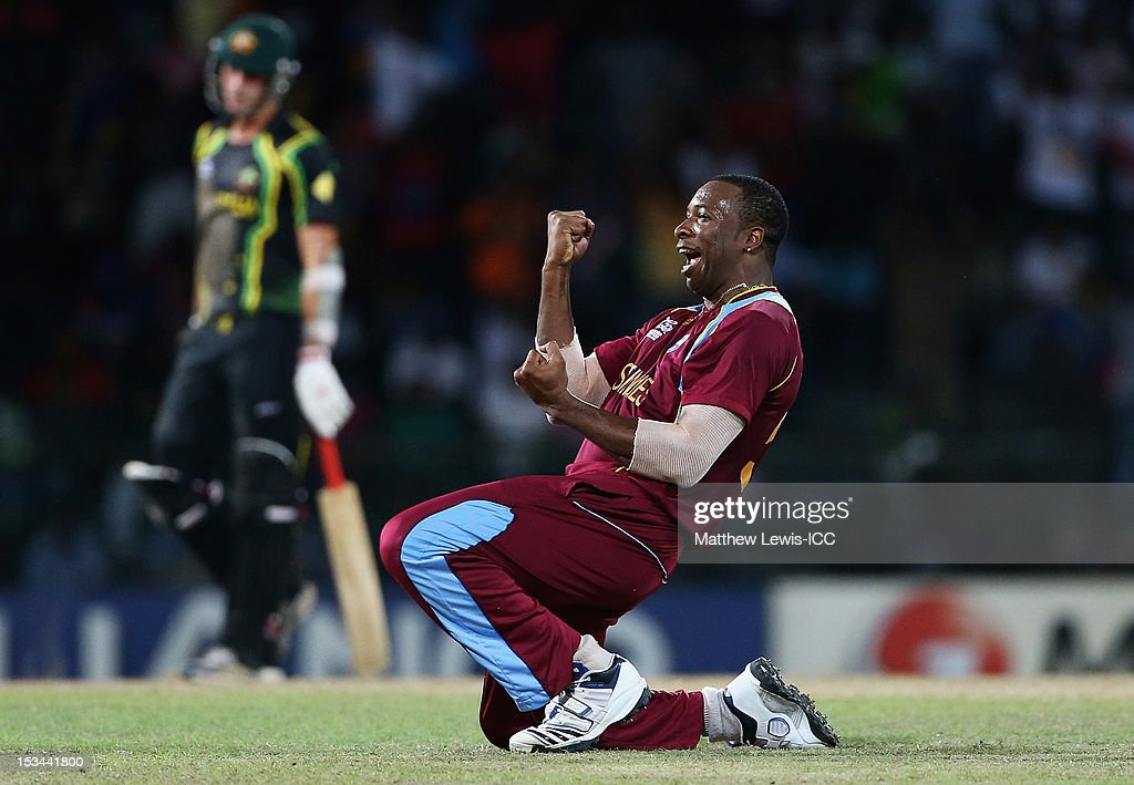 <a gi-track='captionPersonalityLinkClicked' href=/galleries/search?phrase=Kieron+Pollard&family=editorial&specificpeople=4233862 ng-click='$event.stopPropagation()'>Kieron Pollard</a> of the West INdies celebrates the wicket of George Bailey of Australia, after he was caught by Andre Russell during the ICC World Twenty20 2012 Semi Final match between Australia and West Indies at R. Premadasa Stadium on October 5, 2012 in Colombo, Sri Lanka.
