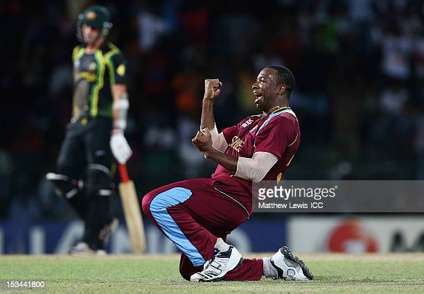 Kieron Pollard of the West INdies celebrates the wicket of George Bailey of Australia after he was caught by Andre Russell during the ICC World...