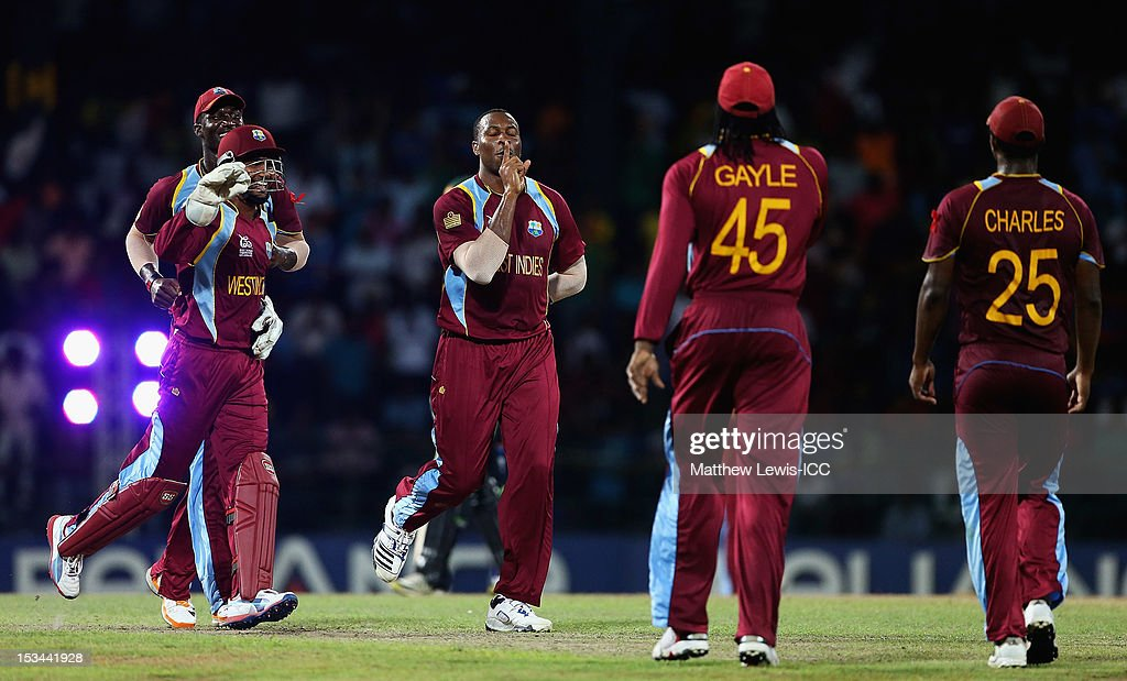 <a gi-track='captionPersonalityLinkClicked' href=/galleries/search?phrase=Kieron+Pollard&family=editorial&specificpeople=4233862 ng-click='$event.stopPropagation()'>Kieron Pollard</a> of the West Indies celebrates the wicket of Pat Cummins of Australia, after he was caught by Johnson Charles during the ICC World Twenty20 2012 Semi Final match between Australia and West Indies at R. Premadasa Stadium on October 5, 2012 in Colombo, Sri Lanka.