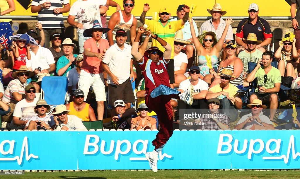 <a gi-track='captionPersonalityLinkClicked' href=/galleries/search?phrase=Kieron+Pollard&family=editorial&specificpeople=4233862 ng-click='$event.stopPropagation()'>Kieron Pollard</a> of the West Indies takes a catch to dismiss George Bailey of Australia during the Commonwealth Bank One Day International Series between Australia and the West Indies at Manuka Oval on February 6, 2013 in Canberra, Australia.