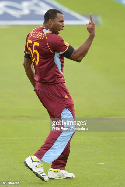 Kieron Pollard of West Indies celebrates after dismissing South Africa batsman Colin Ingram during the ICC Champions Trophy group match between South...