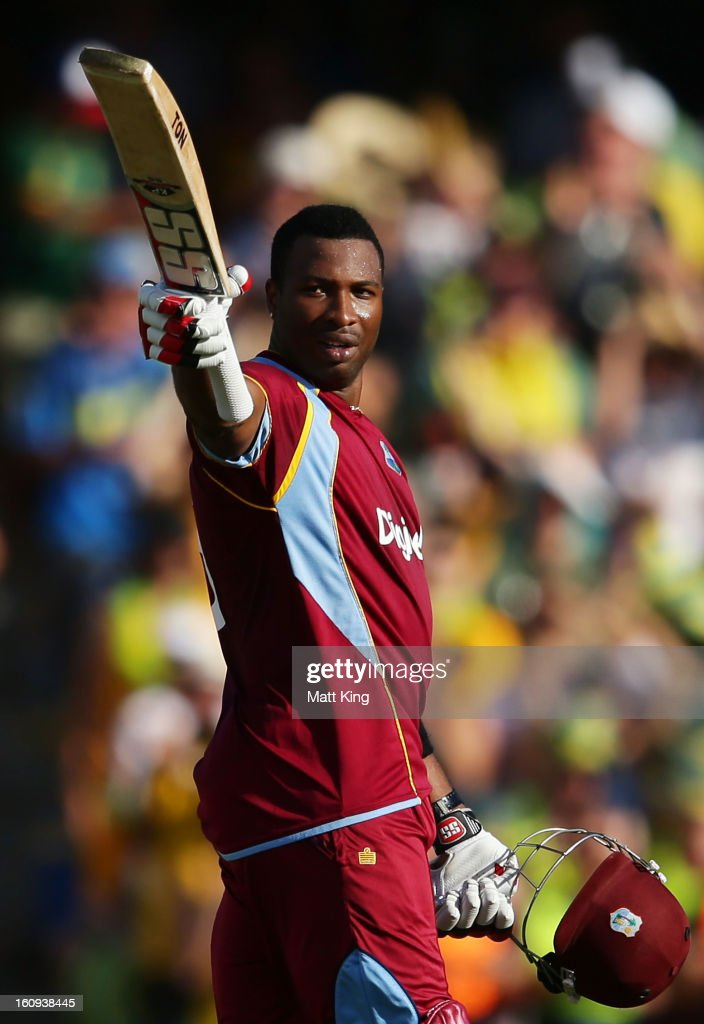 <a gi-track='captionPersonalityLinkClicked' href=/galleries/search?phrase=Kieron+Pollard&family=editorial&specificpeople=4233862 ng-click='$event.stopPropagation()'>Kieron Pollard</a> of West Indies celebrates scoring a century during game four of the Commonwealth Bank One Day International Series between Australia and the West Indies at Sydney Cricket Ground on February 8, 2013 in Sydney, Australia.